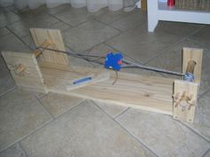 Métier à galon.  That's an interesting way to tension a home made loom.
