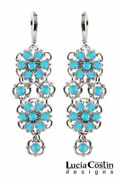 Lucia Costin Lever Back Dangle Flower Earrings Enhanced with Twisted Lines and Turquoise Swarovski Crystals; .925 Sterling Silver; Handmade in USA Lucia Costin. $89.00. Beautifully designed with turquoise Swarovski crystals. Romantic floral design. Lucia Costin dangle earrings. Produced delicately by hand, made in USA. Unique and feminine, perfect to wear for special occasions and evenings