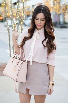 Tiffany from Flaunted and Center looks sophisticated and chic in our blush and white contrast tie-front blouse and a lilac mini skirt | Banana Republic
