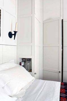 Clever storage for small spaces doesn't come better than these space saving wardrobes in this small bedroom. Small space storage solutions and furniture by House & Garden. Small Bedroom Storage, Bedroom Storage, Bedroom Cupboards, Hallway Storage, Small Bedroom Clothing Storage, Cupboard Storage, Built In Wardrobe, Built In Cupboards, Small Bedroom