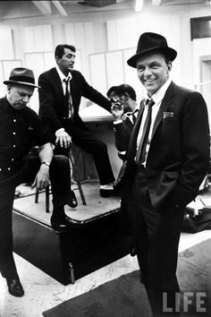 """Circa 1963 – Frank Sinatra, Sammy Davis Jr., Dean Martin & unident. man during recording session for movie """"Come Blow Your Horn."""" –photo by Gjon Mili for LIFE"""