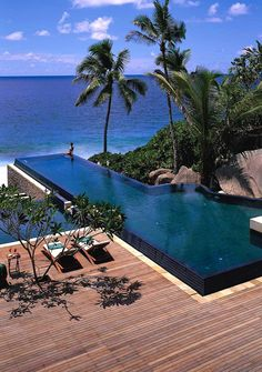 Banyan Tree Seychelles Black tiled interior with infinity edge. Pinned to Pool Design by Darin Bradbury.