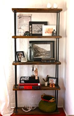 kitchen: diy pipe shelf  I like the board on bottom for stability better than attaching to the wall.
