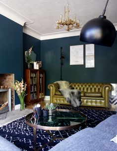 An eclectic lover's living room in dark green. Scandi, vintage, copper details all pulled together with Valspar's Mountain Midnight.