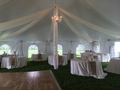 High-Peak Pole Tent, Cathedral Tent Walls, Ivory Kiting with String Lights, Chandeliers, Round Tables with Ivory Linens and Burlap Runners, Dance Floor - Fairy Tale Tents & Events - Tent Wedding
