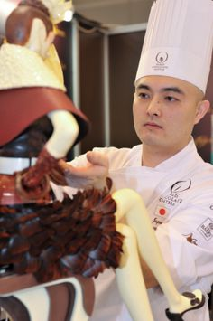 Japanese chocolatier working hard on his intricate chocolate masterpiece.     www.chocomize.com