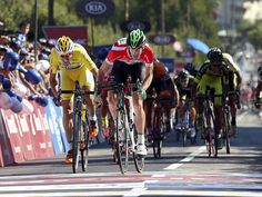 Portugal's Jose Goncalves, right, and Spain's Gustavo Veloso, cross the finish line during the 6th stage of 77th Tour de Portugal cycling race in Oliveira de Azemeis, Portugal. Gustavo Veloso was declared winner.  Jose Coelho, EPA
