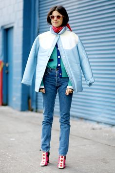Leandra Medine of @manrepeller paired her Levi's with bright boots and warm layers during #NYFW.