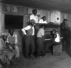 """The first Negroes who played what is called boogie woogie, or house-rent music, were from Texas.  All the Old-time Texans, are agreed that boogie piano players were first heard in the lumber and turpentine camps, dating from the early 1870's.  Boogie was a necessary factor in Negro existence wherever the struggle for an economic foothold had grouped the ex-slaves in segregated communities (mostly in cities along the gulf, the Mississippi and its tributaries).""---Author, Elliot Paul, ca…"