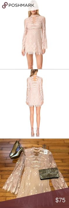 NWT FREE PEOPLE nude/blush lace dress NWT gorgeous long sleeve FP dress. Bought to wear for my birthday, but went with something else. Free People Dresses Mini
