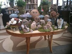 Creekside Garden Center, Nashville, TN  Display of granite hedgehogs and owls for the garden and kitty