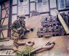 """An abandoned PzKpfw VI Ausf. B 'Königstiger"""" of the 1st company 507th Heavy Tank Battalion -  known as the King Tiger by Allied soldiers, especially by American forces  This is possibly Raymond Hurley, 165th Signal Photo Company (probably assigned to the 1st Infantry Division).  showing the hole made in the turret by a Bazooka.   Osterode, Germany. 12 of April, 1945.  Colour By Richard James Molloy"""