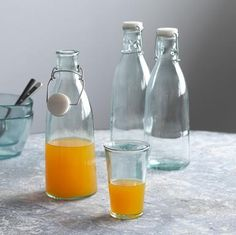 Infused with warm Mediterranean sunlight, our completely recycled glass bottles are ever-so-slightly teal-tinted and meticulously molded for the sort of rough-edged refinement that's perfect for spontaneous gatherings, patio parties and balmy brunches. Not microwave safe. Hand wash. Made in Spain. Exclusive. Set of 3, 32 oz.