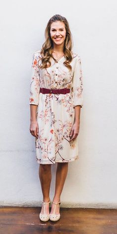 Easton Floral Dress This pretty floral dress features faux buttons in front.  Fabric: 100% Polyester