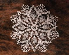 Lovely crochet doily made using thin cotton yarn. Lace round doily of diameter 31 cm / 12 inches. This delicate doily would be great as table