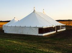 Vintage style canvas pole traditional marquee with a catering add on tent. Looks amazing with re farmers crop behind!