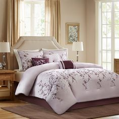 Grace collection is the perfect bed for a room that wants to look updated and modern. The comforter and sham features a beautiful floral pattern that is embroidered on a light purple microfiber ground and is finished with a dark purple flat piping detail. A bedskirt features a solid dark purple color made of soft brushed microfiber. The set includes three decorative pillows to complete the whole look.