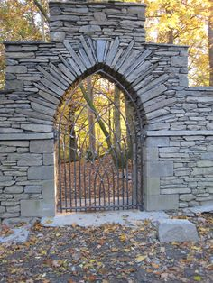 """Gothic arch in slate with wrought iron gate, built by Andrew Loudon."""