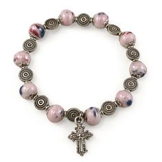 #Catholic #Rosary #Bracelet made with 8 mm Pink Mosaic glass capped beads, silver finish swirl #beads on elastic cord with an oxidized metal cross. Will fit most wrists. Made in #Italy.(sku 1-2811)