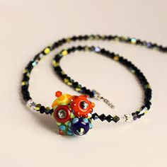 Mulit Cluster on Black Crystal. One-of-a-kind handmade murano glass beads by Felice Designs. Locally made in Charleston, South Carolina. Beautiful jewelry! Shop Online!