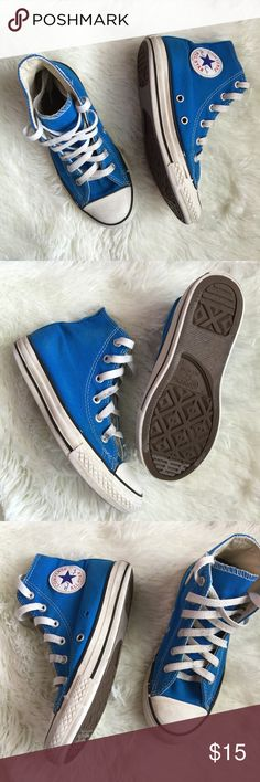 """Blue High Top Converse Pre-owned turquoise blue high top Converse. In good condition, with more life to give a child size 1 (US) in shoe. One ring missing in interior of left shoe, hence the reduction price. See photos for signs of wear.   🚫 TRADES 🚫 LOWBALL OFFERS 💟 Use the """"ADD TO BUNDLE"""" button to SAVE 10% on 3 or more listings & only pay ONE shipping fee!   ✨✨💋HAPPY POSHING✨✨ Shoes Sneakers"""