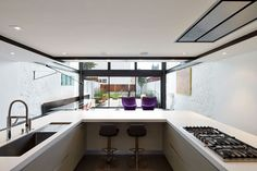 A kitchen with a clever solution for storage.