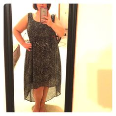 """Torrid High-Low dress EUC!!! Only wore twice...no defects! Beautiful sheer animal print chiffon over top of a stretchy black dress. Slight stretch. Beautiful caged back. Front is knee length, back is long to my ankles (I'm 5'6""""). Very flattering, will look great with a waist cinching belt. Torrid brand fits a size 14/16W. Smoke free home. torrid Dresses High Low"""