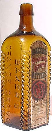Baker's Orange Grove Bitters, fancy roped corners, golden yellow with an amber tone, and original multi-colored label.