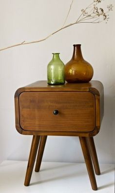 Sophisticated little teak bedside table with one sliding drawer. A simple, practical piece of furniture with smooth lines typical of Scandinavian design. Made by hand in a Danish workshop.