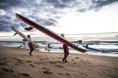 Early morning paddle through the surf at the Kirrawara Surf Life Saving Club, Broadbeach on the Gold Coast, Australia