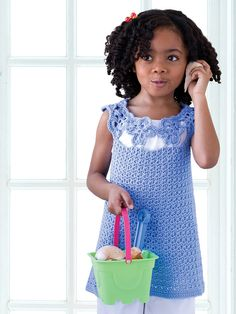 With its sweet flower detail, this crocheted top is fashionable for any little girl. /