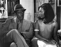 Godfrey Cambridge questions Judy Pace about her boy friend in a scene from the film 'Cotton Comes To Harlem' 1970