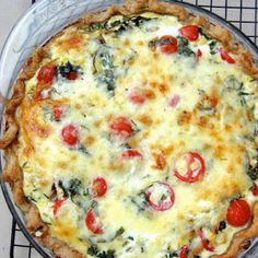Tomato and Fresh Corn Quiche. Cherry tomatoes, yellow onion, milk, extra-virgin olive oil, sharp white cheddar cheese, corn kernels, pie crust, fresh chives, eggs, salt, fresh basil, ground black pepper. Technique: Baking, Technique: Browning, Dish: Quiche, Course: Main Dishes, Equipment: Oven.