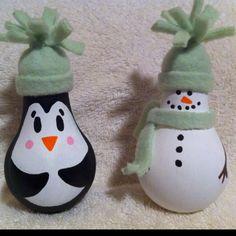 Homemade Christmas ornaments made from light bulbs.