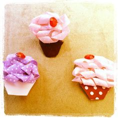 Hand made sculptured cupcake hairclips  with a cherry on top. Nooo! U  carnt eat them but u can wear them in your hair . Contact me for orders