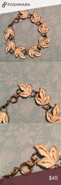 Gorgeous Vintage Bracelet Beautiful Gold tone bracelet with white enamel leaves. It is signed Germany on the clasp. This is a real stunner! Vintage Jewelry Bracelets