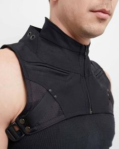 Despite being one of our smaller accessories, the Verge Harness packs a huge aesthetic punch. Featuring two zippered pockets, a double collar and subtle geometric accenting, this harness adds a powerful and unmistakable cyberpunk edge to any outfit. Moda Cyberpunk, Cyberpunk Fashion, Cyberpunk Clothes, Military Fashion, Mens Fashion, Military Outfits, Military Jackets, Military Women, Men's Jackets