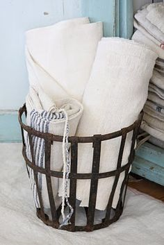 grainsack love ~both the French basket and the grainsacks are available at American Home & Garden in Ventura CA