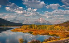 Grand Teton, Wyoming Rugged slabs of rock speckled with glaciers and snowfields protrude through the clouds, and shield the entry to Grand Teton National Park.  Located just south of Yellowstone, this park is often overlooked and is not nearly as accessible as its neighbor