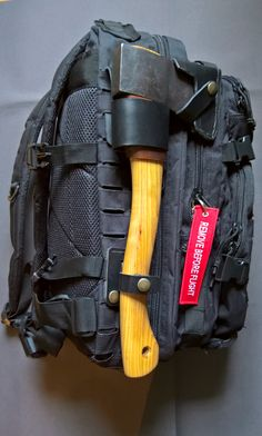 Husqvarna hatchet attached to my MOLLE style drag pack. The axe loop also dobbels as a belt loop