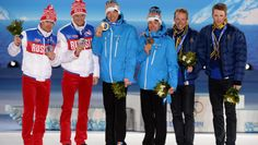 Russia's silver medalists Maxim Vylegzhanin and Nikita Kriukov, Finland's gold medalists Iivo Niskanen and Sami Jauhojaervi and Sweden's bronze medalists Emil Joensson and Teodor Peterson posing during the men's cross-country team sprint classic Medal Ceremony.