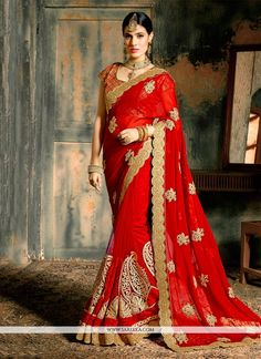 Designed with simplicity with a touch of soberness in its work makes a masterpiece. This red georgette and net designer saree is including the desirable glamorous displaying the sense of cute and grac...