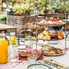 The Grounds of Alexandria - high tea stands and fresh orange juice
