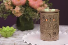 A taupe background and slender lines of earthy brown combine to give a fragrance-filled nod to the ancient art form of henna - a special cultural body painting used to denote joyous occasions. Enjoy its beauty in the form of intricate flowers wrapped around the surface of this Scentsy warmer. http://getscentstogo.com/products/henna-scentsy-warmer