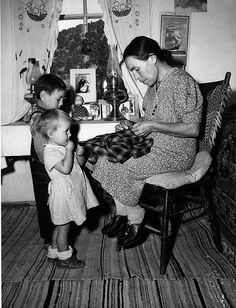 Mrs. Maclovia Lopez and her children      Mrs. Lopez has many responsibilities in the family, such as cooking, washing, spinning, and sewing, as seen here, Trampas, New Mexico, 1943