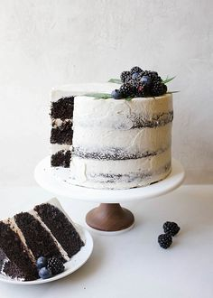 Black and White Cake By Wood and Spoon Blog by Kate Wood. This is a dark chocolate cocoa powder cake, made easily in one bowl, layered with a cooked flour vanilla bean frosting and a blackberry and dark chocolate ganache. This is a layer cake that is stunning and can even be used as a party/ wedding cake. The berry ganache is made with jam and cream. The cake is moist and fluffy, incredibly simple, and the frosting and smooth, light, and creamy cloud like.