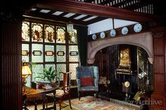 The massive inglenook fireplace and floor-to-ceiling stained glass window in the entrance hall of Wightwick Manor, an Arts and Crafts house near Wolverhampton designed by Edward Ould Fireplace Lighting, Inglenook Fireplace, Fireplaces, Arts And Crafts House, Diy Arts And Crafts, Belton House, English House, English Manor, English Style