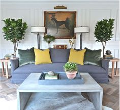 Symmetry and muted colors with a pop of mustard //living rooms