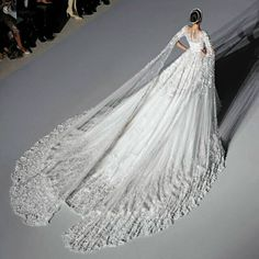 For the love of wedding dresses.Nothing is more prioritized by a bride on her wedding day than her dress and we will be taking our time to show you some amazing wedding dress designs. Wedding Wedding Day Wedding Dress Weddings Planner Your Big Day Wedding Dress Train, Dream Wedding Dresses, Bridal Dresses, Wedding Gowns, Bridesmaid Dresses, Cathedral Wedding Dress, Wedding Ceremony, Wedding Bride, Lace Bride