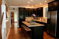 "design dump: house #5: kitchen before/after.  Love the black cabinets ""onyx black"" with light counter"
